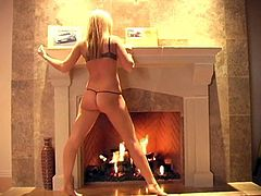 Blonde hottie Alison Angel slowly slithers out of her tiny thong and proceeds to finger fuck her pussy in front of the fireplace.