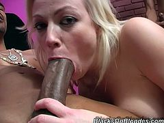A slutty blonde girl gets rammed by three Black guys