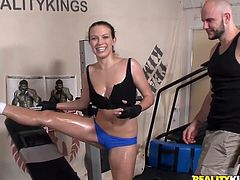 Check this brunette, with a nice ass wearing sportive clothes, while she gets drilled hard after serving a great handjob. She is on fire!