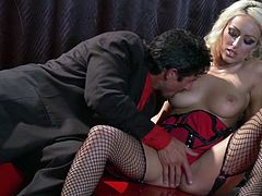 Captivating blonde Breanne Benson wearing a corset and fishnet stockings gives a great blowjob to some man and lets him eat her shaved pussy. Then they fuck doggy style and in cowgirl position and enjoy it much.