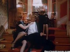 The Classic Porn brings you an amazing free porn video where you can see how some vicious vintage lesbian maids share a hard cock on the stairs while assuming very hot poses.