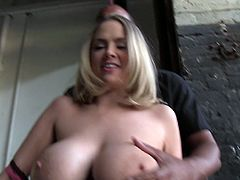 Katie and her man get a little wild as she sucks his black cock while he plays with her monstrous melons and shaved pussy.