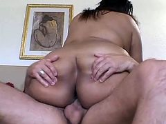 Witness this clip where a brunette BBW, with enormous boobs wearing shinning underwear, while she gets nailed hard and moans loudly.
