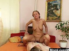 A blonde MILF is sleeping in her bedroom. Some mature slut with huge hanging boobs wakes the MILF up. They lick and toy each others pussies lying on a bed.