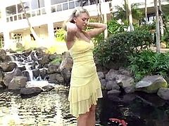 Take a nice look at this blonde girl, with big bazookas wearing a yellow dress, while she shows her intimate parts in a solo model video.