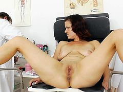 Naughty milf turns horny while doc's hands are stretching her puffy twat