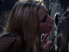 Stunning Lindsey Meadows sits in the glass box with holes in it. Any guy can come up and push his dick through any hole. Lindsey gives a hot blowjob to anyone.