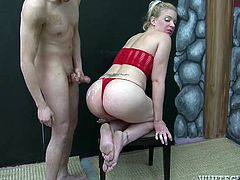 Horny blonde dominatrix Heidi Mayne is having fun with some masked guy. She beats his balls with a lash and then kneels in front of him and sucks his dick.
