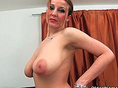 Soccer mom Brenda shows off her amazingly big tits and fucks her snatch with her favorite toy. She spreads her legs wide and sticks the dildo deep to make herself cum.