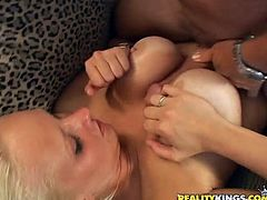 Zoey sucks a dick standing on her knees and gets titty fucked. This horny girl also gets pounded in a reverse cowgirl position.
