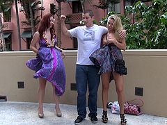 Melody and Lena Hawaii walk around a town. They lift their dresses up to show asses. After some time they sit down on the steps and start to rub each others pussies.