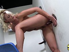 What are you waiting for? Watch this blonde babe, with natural boobs and a great ass, while she goes hardcore with big black poles in a gloryhole.