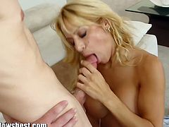 Horny blonde MILF Alyssa Lynn is fucking with her young trainer at the gym while her husband is waiting at home. She starts blowing his cock to make him cum on her face.