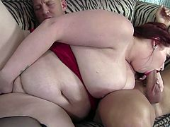 Check out this hardcore scene where the gorgeous redhead BBW is fucked by a big cock after she almost devours this guy's thick cock.