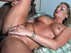 Sweating blond milf goes interracial with two