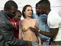 Have fun watching this short haired brunette, with natural breasts wearing a miniskirt, while she goes hardcore with a bunch of dudes.