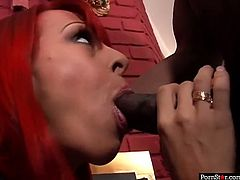 Big breasted and naughty redhead Whiteney Wonders takes off her sexy teacher outfit and giver her man a nice deepthroat.