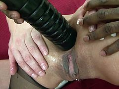 Czech beauty Klarisa is a naughty one. She can't decide which kind of cock she likes more, should it be black or white? After she was warmed up with a serious dildo fuck in the ass, Klarisa knelt, grabbed both dicks and started sucking them hard. Which one will cum first on her slutty face?