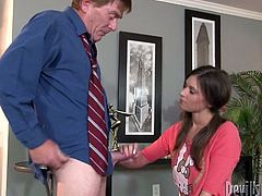 Pretty and charming brunette in cute pink outfit sucks two cocks at the same time and lets them pound her holes missionary style.