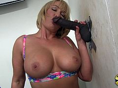 Get a hard dick watching this short haired cougar, with immense tits wearing a cute bra, while she goes hardcore with a big black cock.