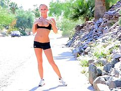 Pretty chick Melissa wearing sport clothes is having fun outdoors. She jogs for some time and then strips and shows her natural tits and shaved coochie for the camera.