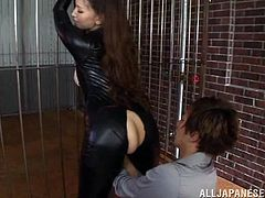 She's tied on the prison bars and the guy she's with is anxious to play with her body. Who could blame, just look at this whore and how good her black spandex costume fits her. The bitch has nothing to do but obey and wait for him to finish as he unzips her pants, plays with her ass and then wants more!