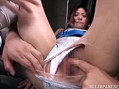 They pull down her blouse and start licking her nipples. Her shorts get pulled aside to display her amazing vagina and the two men start prodding at it. She is so fuckable. Watch as she gets fucked hard from behind and sucks cock all at once.
