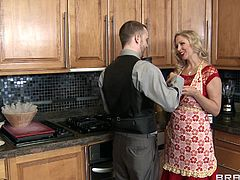 Julia is a hot house wife! Yeah, this milf knows how to cook a meal and how to satisfy a guy, not always her husband! She's in the kitchen, cooking when the milk man pays her a visit. with her man away and a pussy that was itching her all day long, Julia gets naughty with the milk man and sucks his dick for his milk!
