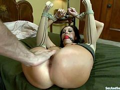 Ava Addams is a luscious French milf who has her legs bound to her arms so her hole can be easily accessed. This submissive slut takes James Deen's rock hard cock. He thrusts his dick into her pussy fast and hard. Before he's done, he puts clamps on her pointy nipples. She's happy to take the pain.