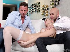 She's blonde, young and never says no to cocks! Meet our gorgeous nanny Mira, one hell of a beauty, that's about to be fucked hard and deep by these two. The guys grabs her milky white boobs and ass, lay her on the couch and then, eat her pussy and fuck her mouth. That's only the warm up, don't miss this action!