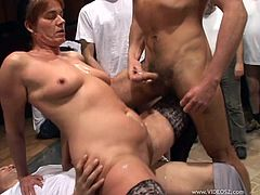 Have fun with this hardcore scene as you watch this horny granny being gangbanged by horny fellas as she ends up covered by warm cum.