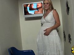 Press play to watch this pregnant blonde, with natural boobs wearing white panties, while she sucks a big schlong in a gloryhole until the guy cums.