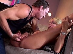 Gorgeous blonde Stormy Daniels is getting naughty with some man in the living room. The stud fingers Stormy's coochie and then they bang in the reverse cowgirl and other positions.