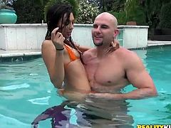 Jmac and Serena have some good clean fun in the water. Oh, wait, things are not so clean! It looks like this cutie is a really slutty one and Jmac tries his luck with her. He removes her swim suit, spreads her legs and then, get out from the swimming area and gives the pretty brunette a hard cock in the mouth!