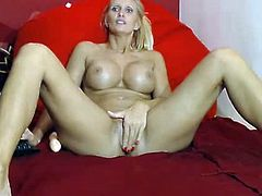 Blonde fingers her ass and pussy