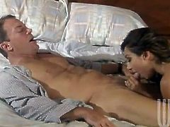 Pretty Roxy Jezel gives a blowjob to some man. Then the guy favours Roxy with cunnilingus and they bang in missionary position.