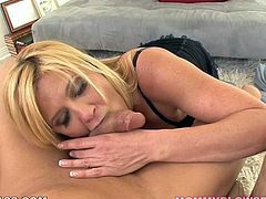 Tempting blonde beauty Ginger Lynn peels her man's jeans down and starts sucking his shaved sweaty balls. When dick gets hard Ginger blows it with attitude.