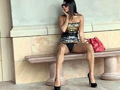Captivating brunette Shazia flashes her amazing body in the street