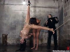 After being kept in an uncomfortable position like cheap sex slaves, these girls now receive a fast clean up. One of them is hanged with her legs spread and gets her body cleaned with a water jet. Her gf is then putter to lick that freshly cleaned pussy. Watch what else happens!