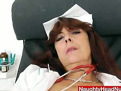 At the end of a long day this horny nurse shed her uniform and proceeded to fuck her pussy with a toy right there in the office.