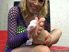 Black Meat White Feet brings you a hell of a free porn video where you can see how the hot blonde Lily LaBeau footjobs a big black cock while assuming very naughty poses.