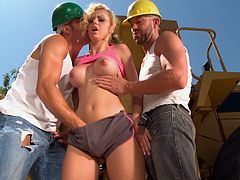A petite blonde girl gives pleasure to two builders. They work hard and she helps them to relieve stress. Jessie gives a hot blowjob to guys and then gets gets fucked in both holes.