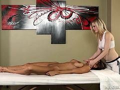 Things start out innocent enough, but when there are two beautiful women involved and one is naked, you know things are going to get sexual. The client gets her perky breasts rubbed by the masseuse. Her aching muscles are rubbed, including her hands. Which girl will make the first move?