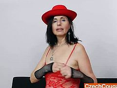 The famous brunette dame Nadezda does a mind blowing solo video with her skin colored vibrator in her red fishnets lacy dress.