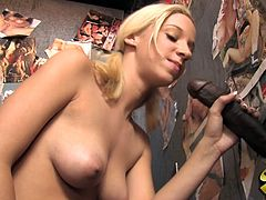 Check this blonde babe in pigtails, with big jugs and a shaved kitty, while she has interracial sex in a gloryhole and moans like a slut!