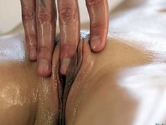Beautiful Julie lays naked and relaxes as her masseur rubs her perfect body with oil. He slides his hands on her back and on that cute ass before she turns over. After massaging her tits and pussy Julie starts to feel horny and grabs his dick. See how gently she puts it in the mouth and sucks it all up?