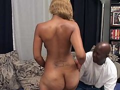 This ebony slut has dyed her hair blonde and now she is ready to suck dick and her floppy tits swing around. Her man rubs her nipples and then she leans in to suck on his massive black pecker. She sucks cock like a pro and sticks her big black ass right in the camera so you can get a good look at it's round splendor.