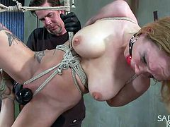 That's what she deserves, for being a filthy whore! Rain is receiving what needs and deserves right about now, as the executor tied her up and hanged her. He doesn't shows this cheap cunt any mercy and rubs her pussy hard with that vibrator. Of course that's only the foreplay!