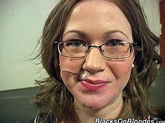 Kinky blonde Brandy Dallas wearing glasses is trying to satisfy a few black dudes. She sucks and rubs their BBCs and feels happy to get her face covered with cum.