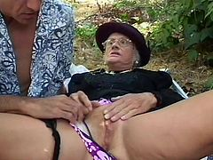 Gino has agreed to take his friend's granny out for a walk because she is senile and can't go herself. While out in the woods she jumps Gino's bones because she thinks he is her dead husband. He says what the fuck and eats her pussy and makes her cum.